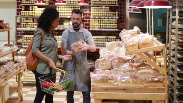 Baker helping customer in grocery store