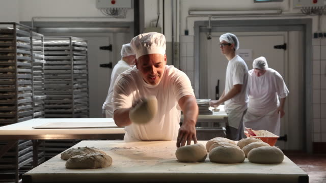 baker making bread, kneading dough - loaf of bread stock videos and b-roll footage