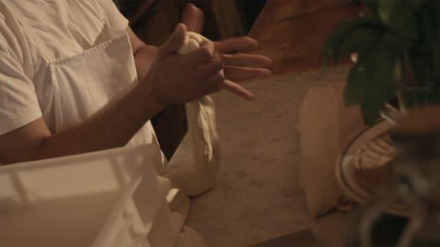 ms baker making buns in bakery / bologna, italy - brot backen stock-videos und b-roll-filmmaterial