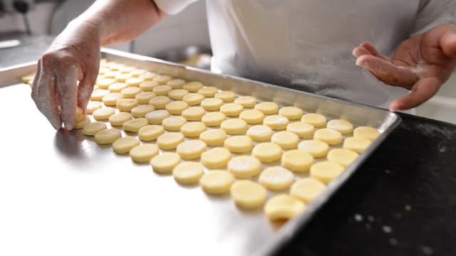 baker making cookies - baking tray stock videos & royalty-free footage