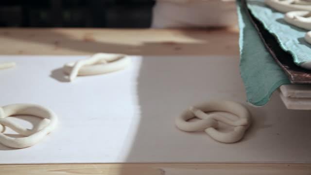 Baker making pretzel dough in bakery