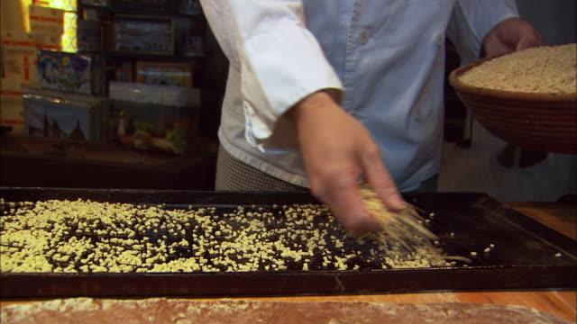 ms baker making traditional gingerbread (lebkuchen) / nuremberg, bavaria, germany - crumb stock videos & royalty-free footage