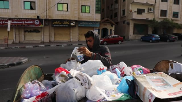 baker marouf looks for items to recycle in trash on may 11, 2018 in gaza city, gaza. for the 1.9 million palestinians living inside the gaza strip... - 14 15 years stock videos & royalty-free footage