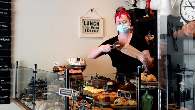 baker opening shop after the coronavirus lockdown - serving food and drinks stock videos & royalty-free footage