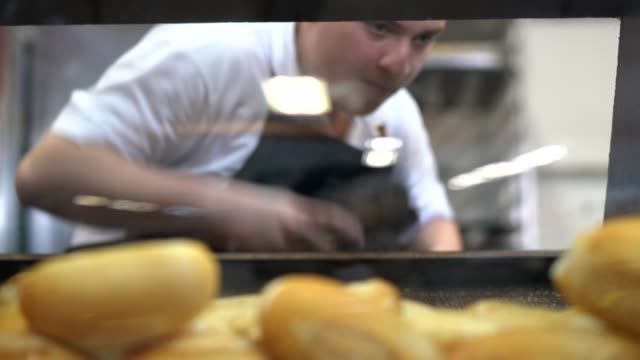 baker picking fresh bread in bakery - bread stock videos & royalty-free footage