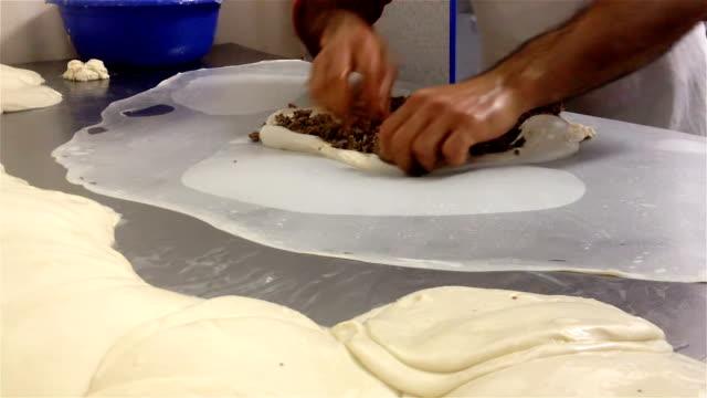 Baker prepares traditional Burek (Börek) or Phyllo Meat Pie