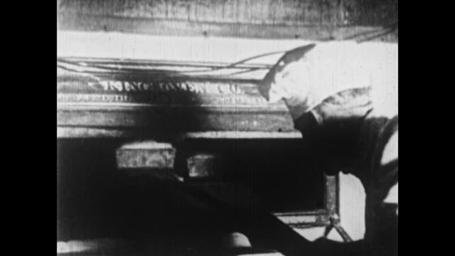 1926 a baker removes loaves of bread from an oven - 1926 stock videos & royalty-free footage
