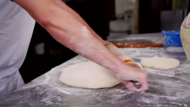 baker rolling the dough - rolling pin stock videos & royalty-free footage