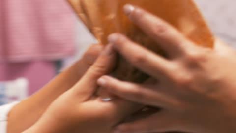 baker serving customer - paper bag stock videos & royalty-free footage