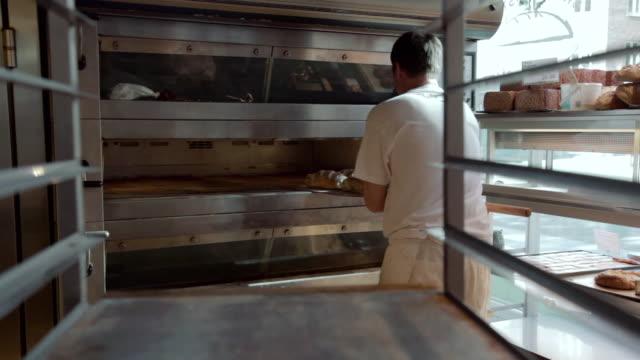 MS TD Baker taking bread from oven to griddle / Copenhagen, Seeland, Denmark