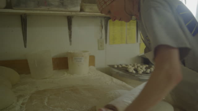 baker using rolling pin preparing dough in bakery / pleasant grove, utah, united states - rolling pin stock videos & royalty-free footage