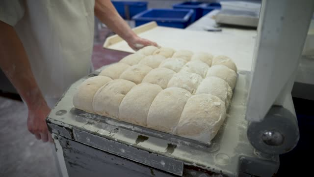 bakers are seen working at the bread factory on april 14, 2020 in london, england. during the covid-19 outbreak and lockdown, the bakery-and-cafe... - イベントまとめ動画点の映像素材/bロール