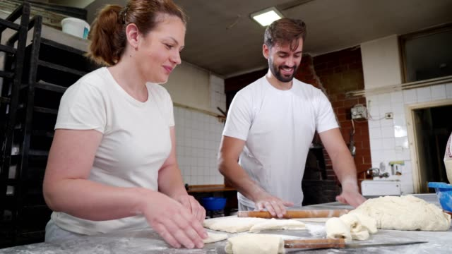 bakers at work - rolling pin stock videos & royalty-free footage
