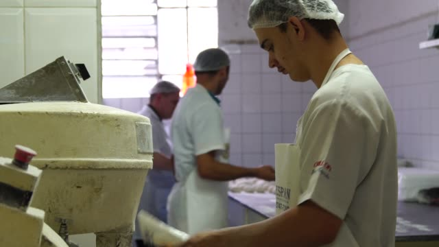 Bakers working in the professional kitchen at Bakery