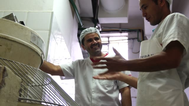 bakers working in the professional kitchen at bakery - etnia latino americana video stock e b–roll