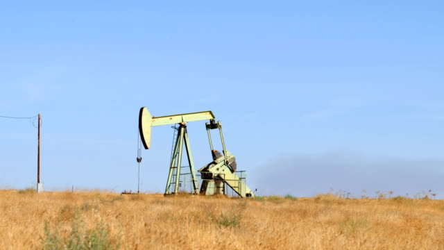 bakersfield, ca oilfields - pump jack stock videos and b-roll footage