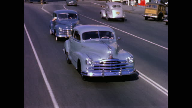 1948 bakersfield street traffic montage - 1948 stock-videos und b-roll-filmmaterial