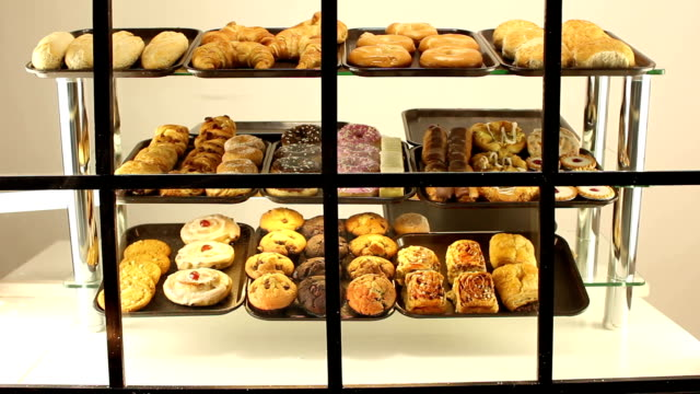 bakery / cake shop window - dolly - pain au chocolat stock videos and b-roll footage