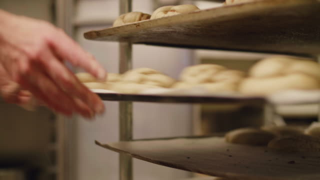 bakery cinnamon bun dough plates - flour stock videos and b-roll footage
