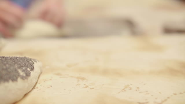 bakery close up dough rolled in poppy seeds - wood grain stock videos & royalty-free footage