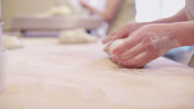 bakery hands baking bread on table with flour - wood grain stock videos & royalty-free footage