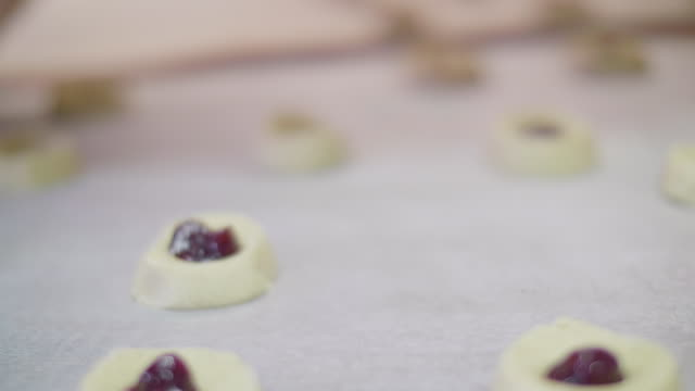 bakery jam cookies being prepared - doughnut stock videos and b-roll footage