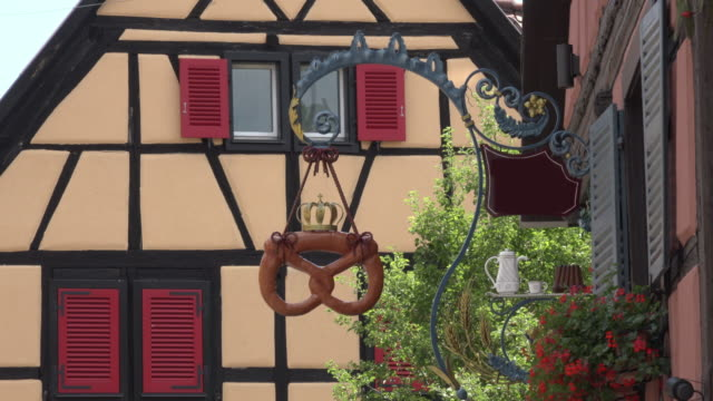 Bakery sign with pretzel at half-timbered house