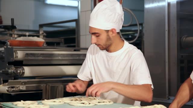 Bakery team making pretzel dough together