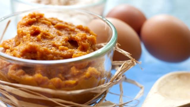 baking a pumpkin cobbler, pie for thanksgiving dinner. - pumpkin stock videos & royalty-free footage