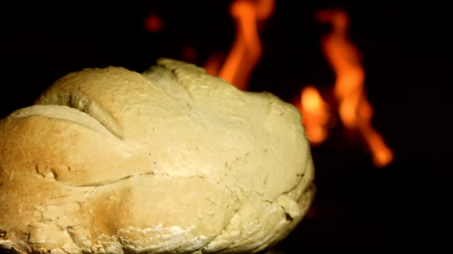 hd: baking bread in brick oven - peasant bread stock videos and b-roll footage