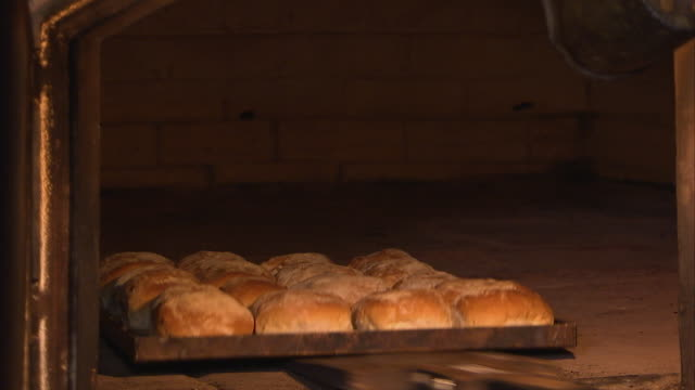 baking bread inside an old oven - oven stock videos & royalty-free footage
