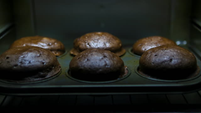 baking chocolate muffins: concept - blueberry muffin stock videos & royalty-free footage