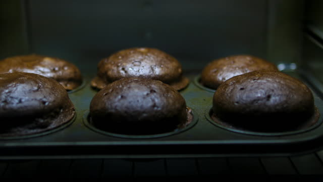 baking chocolate muffins: concept - baking stock videos & royalty-free footage