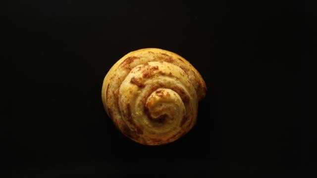 baking cinnamon rolls: concept - cinnamon stock videos & royalty-free footage