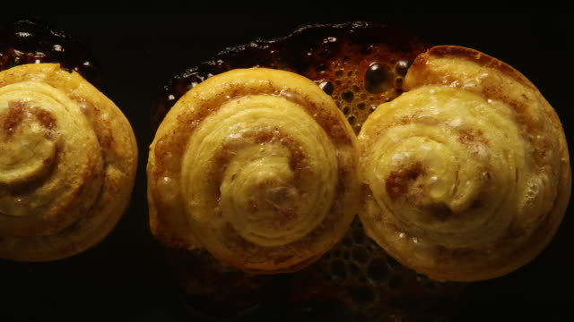 baking cinnamon rolls: concept - oven stock videos & royalty-free footage