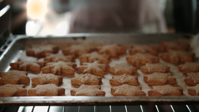baking gingerbread cookies in the oven - biscuit stock videos & royalty-free footage