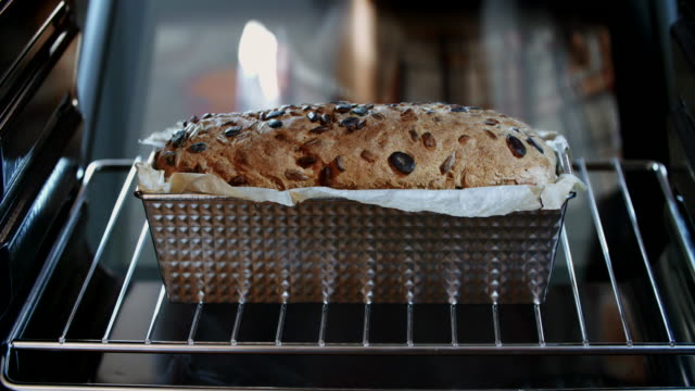 baking homemade seed bread in the oven - baked pastry item stock videos and b-roll footage