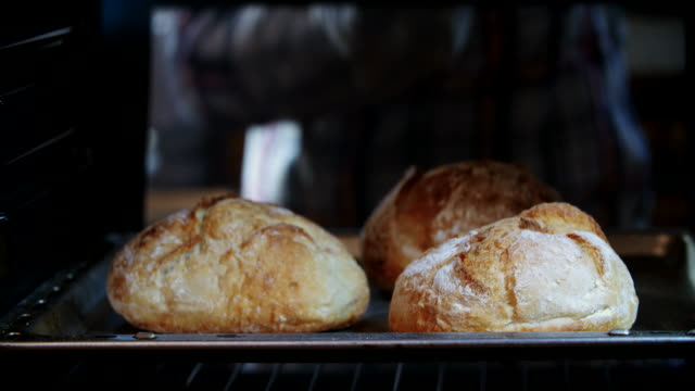 baking homemade seed bread in the oven - loaf stock videos & royalty-free footage