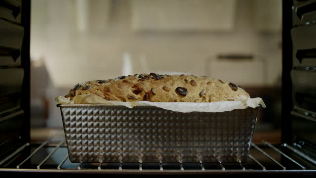 baking homemade seed bread in the oven - cream cake stock videos & royalty-free footage