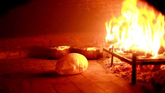 baking in a stone oven - hearth oven stock videos & royalty-free footage
