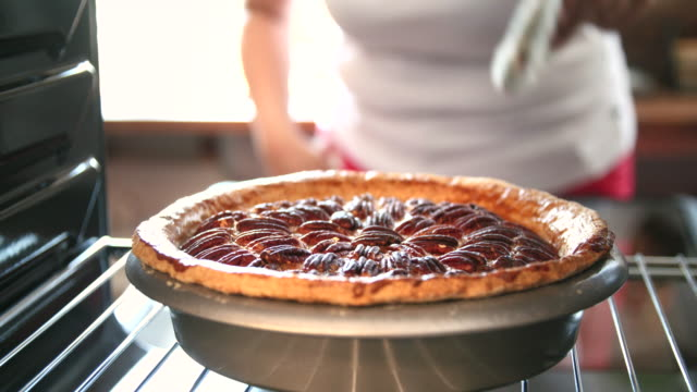 baking pecan pie in the oven for holidays - baking stock videos & royalty-free footage