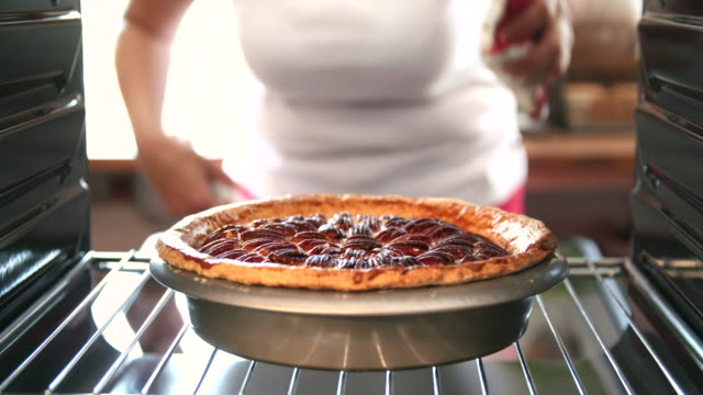 baking pecan pie in the oven for holidays - home made stock videos & royalty-free footage