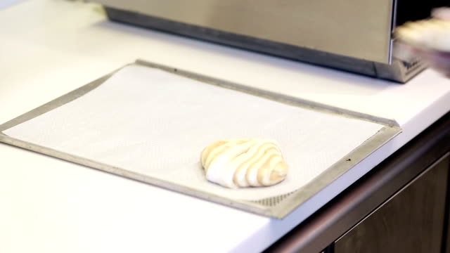 baking pies of puff pastry on tray - baking tray stock videos & royalty-free footage
