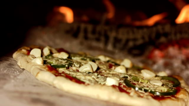 hd: baking pizza in the oven - hearth oven stock videos & royalty-free footage