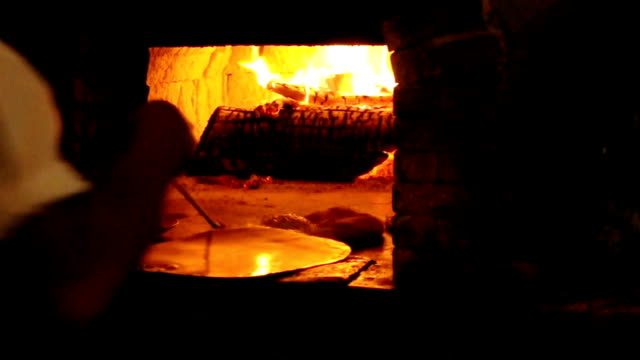 baking pizza. - pizza oven stock videos and b-roll footage