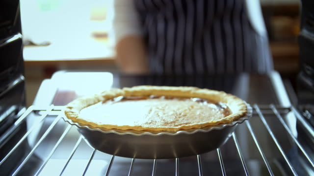 Baking Pumpkin Pie for the Holidays in the Oven - 4k Video