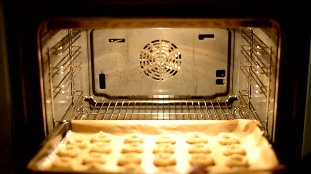 baking traditional german christmas cookies in oven - oven stock videos & royalty-free footage