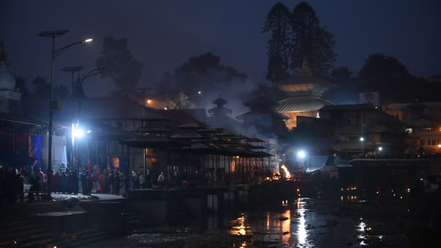 bala chaturdashi is one of the religious hindu festivals devoteesscatter seven types of grains in the early morning at thepashupatinath templeit... - pilgrim stock videos & royalty-free footage