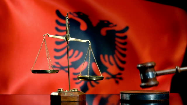 balance and gavel with albanian flag - eastern european culture stock videos & royalty-free footage