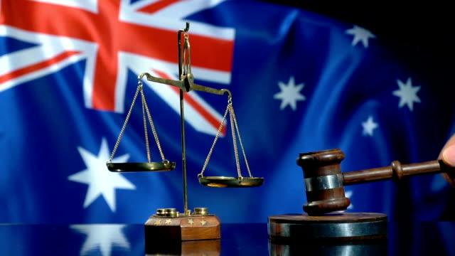 balance and gavel with australian flag - british culture stock videos & royalty-free footage